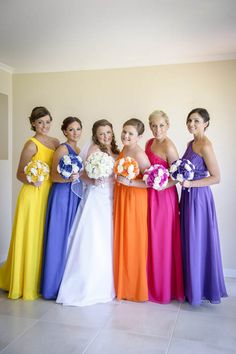 Multicoloured bridesmaid dresses with matching bouquets for Lisa's wedding. Photographed by Marc Grist Photography Rainbow Bridesmaid Dresses, Bridesmaid Dresses Different Colors, Rainbow Wedding Dress, Unicorn Wedding, Wedding Processional, Multicolor Wedding, Wedding Colors, Wedding Ideas, African Print Clothing