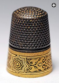 This steel thimble was made in Germany and sent to Toledo in Spain for damascene decoration. The steel has been oxidized and a gold pattern has been inlaid in an Islamic design around the border. Vintage Sewing Notions, Vintage Sewing Machines, Sewing Spaces, Sewing Material, Tatting Patterns, Sewing Tools, Sewing Accessories, Vintage Buttons, Pin Cushions