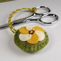 Embroidered Felt Scissor Fob - Gold and Cream Flower on Green by TheBlueDaisy, via Flickr