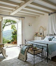 French countryside. I can imagine reading and napping on that bed.