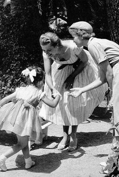 Princess Grace teaching little Princess Caroline to curtsy