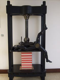 book press with a three-legged handle by keight