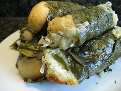 Ukrainian dish called Holipchi which is a little roll that is baked with a green leaf around it (the original recipe called for beet leaves but I used swiss chard) & then serves with a garlic dill sauce.
