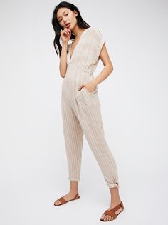 Dancing Horses Jumpsuit | Striped jumpsuit featuring a V-neckline, rolled sleeve cuffs and cute knot details at the ankle.    * Side pockets   * So soft and lightweight fabrication   * Back keyhole cutout   * Elastic at the waist for a comfortable fit   * Slim through the leg