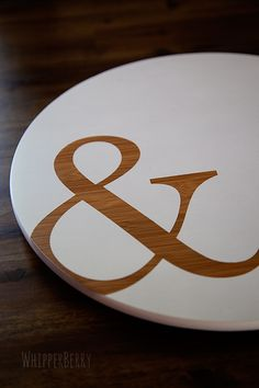 Ampersand Lazy Susan  Not that I'm crazy over the ampersand...more that this gave me a zillion ideas on how to make a Lazy Susan fun...paint, stencils...etc