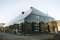 Printed in glass brick facade - Fachada tradicional de ladrillo visto, impresa sobre caja de cristal //  MVRDV