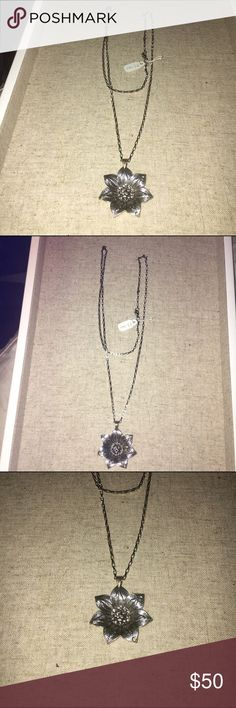 Silver Flower Necklace NWT Silver Flower Necklace NWT, sterling silver necklace with decorative pewter flower. New with tags. ❤️ No Trades❗️ Travel Gems Jewelry Necklaces