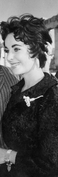 Elizabeth Taylor. -- Someday I'm going to be looking for a shorter haircut again.  I like this one.  I like the layers.