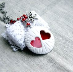 White round pendant with two clipped hearts by OPStyle on Etsy, $20.00