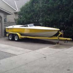 1993 Donzi 18 2+3 Classic Yellow hull and deck stripe. The engine is a 351 Ford Cobra tuned port injection. The out-drive is OMC Cobra.