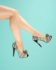"""Lolita Pump in Serape Print - With great pleasure we present Pinup Couture shoes!  Partnering up with the same company that brought you the fabulous Bordello line, we've worked to design a line of beautiful and affordable vintageinspired shoes that will live in perfect harmony with the rest of your PUG wardrobe.  The """"Lolita"""" pump in multi-print features a peep toe, a shiny black 5.25"""" contrast heel, a concealed 1"""" platform, and a ruffle detail at the vamp."""