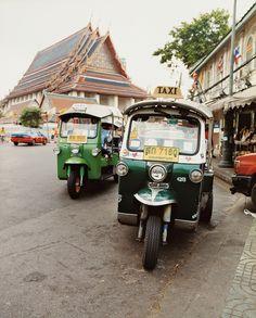 bankok thailand tuk tuks parked grand palace