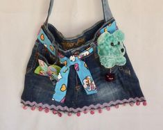 Items similar to Repurposed Denim Crossbody Bag on Etsy Diy Denim Purse, Denim Tote Bags, Denim Boho, Jeans Denim, Denim Bracelet, Granny Square, Wet Bag, Recycled Denim, Crossbody Bag