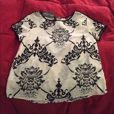 Black and white floral design lightweight shirt Lightweight, floral designed shirt with original tag. Never worn. Tops Blouses