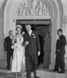 August 9, 1949: Actor Jimmy Stewart and Gloria H. McLean walking out of Brentwood Presbyterian Church after their wedding ceremony.