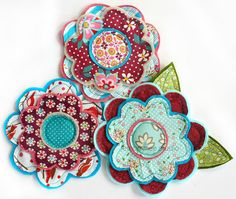 layers of different sized felt and quilting fabric  flowers sewn together