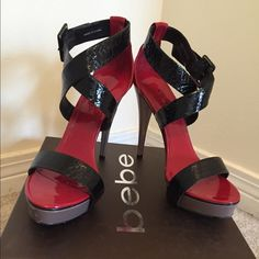 "bebe black/firecracker 4.5"" heels Worn and loved. These shoes are the centerpiece of every discussion. Looks amazing with black dress. bebe Shoes Heels"