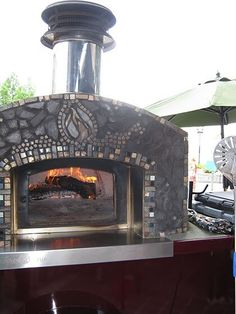 Food trucks, eat your heart out. This beautiful mosaic pizza cart is a caterer's dream. It can produce authentic pizza for any event.