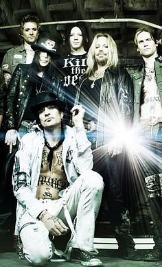James with DJ, Vince Neil, Tommy Lee and Mick Mars