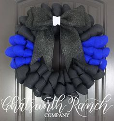 Made with yards & yards of fluffy burlap, this wreath is the perfect Thin Blue Line wreath. The wreath photographed is 20-21 in diameter and is available with or without the We Back the Blue plaque. Please make your selection on which you'd prefer during checkout. If there is something youd like to add or change in any wreath, please contact us. We love making custom orders! All of our wreaths come with a coat of UV Spray to help prevent fading in the harsh sunlight. **TURNAROUND** All w...