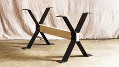 Steel dining table legs, trestle style. These legs are made using 1/4 thick x 5 wide flat bar. These are great for DIYers and crafters, as almost any size cross beam can be used. Just find a through-bolt to fit your beam, and the legs are bolted to themselves, squeezing your beam
