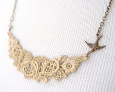 Lovely!! Would look so pretty with so many of the ruffled tops out right now. Gold Lace Necklace - Laurelin - Lace Jewelry. $25.00, via Etsy.