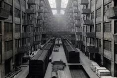 """The """"Well"""", US Signal Corps Army Base Terminal, Port of Embarkation. Ration cases from crate cars are hoisted to warehouse bins for storage, ca. 1945-1946. (Courtesy NYC Municipal Archives)"""