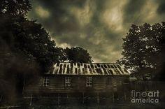 Dark haunted barn with broken windows in slightly obsured fog under gloomy night skies. Grim structures by Ryan Jorgensen