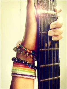 If you can picture who this hand belongs to, it looks like mine when I play. A dozen bracelets, and a hand on that first fret :)