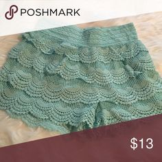 Lace shorts Aqua blue shorts with layered lace detail. Never worn. Stretch waist Shorts