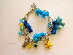 Inspiration: Yellow and Turquoise Summer Bracelet #Summer #tutorial #howto #diy #inspitayion #bracelet #hippie #chain #bead #dolphin #charm #fish #starfish