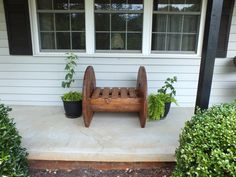 Large wooden spool made into a bench