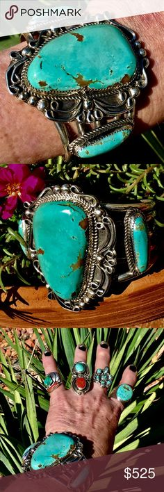 """Navajo Darren Nez Sterling Turquoise Cuff Hand Wrought in Sterling Silver & Natural Turquoise By Navajo Artisan, Darren Nez. Cuff is 2 1/2"""" at Center, 5-Shank & 13/16"""" Tall at gap. Center Stone- 1 1/4"""" (3cm) x 2"""" (5cm) Tall, w/Side Cabs Approx. 1 1/16"""" (28mm) ea, all Saw Tooth Bezel Set w/Twisted Sterling Rope at base of Bezel, Traditional Twirls & Silver Balls from 3-5mm. It is 2 1/2"""" W (across) 6 1/2"""" around w/a 1"""" gap, totaling 7 1/2"""". Stone color is more green than Blue, have no damage…"""