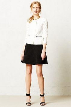 I like the cut of this skirt.  A tad too short for me, but otherwise very cute.