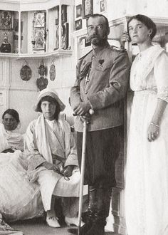 Tsar Nicholas II of Russia at the Livadia Palace surrounded by three of his daughters: from left to right are Grand Duchesses Marie, Anastasia, and Olga Nikolaevna of Russia.