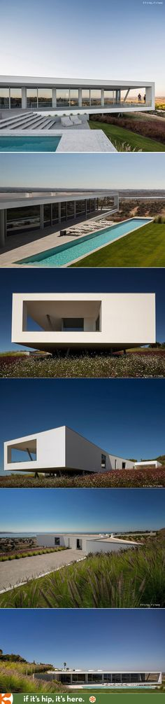 The new horizontally linear Casa Zauia appears to balance on the landscape with panoramic views of Portugal's Alvor Estuary and Lagos Bay.