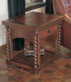 Rafaela End Table Western Cocktail and End Tables - The plank wood lower shelf and sides are accentuated by spiral wood leg design on all four corners. The table top features a hand tooled leather panel punctuated with nail accents. The leather paneled drawer front is highlighted with forged pull.