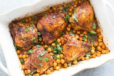 One pot easy baked chicken thighs with smoked paprika, onions, and chickpeas!