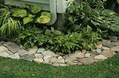 Love this rock border! Put down a weed barrier (cardboard, newspaper or weed blocking material) under rocks....