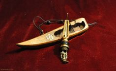 hand crafted jaw harp with special design. The handle stylized as a god Ganesha fugure.