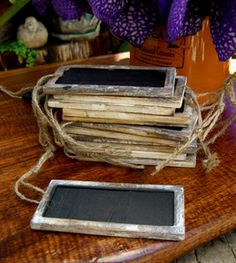 Would be cute for a photo booth, guests can write messages on :Chalkboard Tags with Wood Frame, Double Sided 12pc