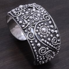 """Large Sterling Silver Cuff Stamped """"925"""".   This is not a stock photo. The image is of the actual article that is being sold  Size: 1.4 inches wide. Weighs: 57.22 grams (heavy)  Sterling silver is an alloy of silver containing 92.5% by mass of silver and 7.5% by mass of other metals, usually copper. The sterling silver standard has a minimum millesimal fineness of 925.  All my jewelry is solid sterling silver. I do not plate.   Hand crafted in Taxco, Mexico.  Will ship within 2 days of order…"""