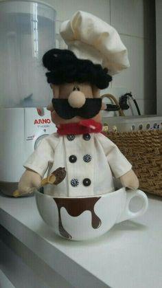 Boneca na xícara cozinheiro