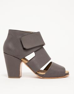 Rachel Comey's signature downtown cool in a pebbled leather heeled sandal. Versatile, with chunky, covered heel, open toe styling with thick straps covering the vamp, and simple buckle closure.