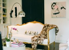 Such talent! christine-dovey-asbury-living-room-16-antique-settee-faux-fur-throw-arc-lamp-fashion-print-abstract-artwork-black-doors