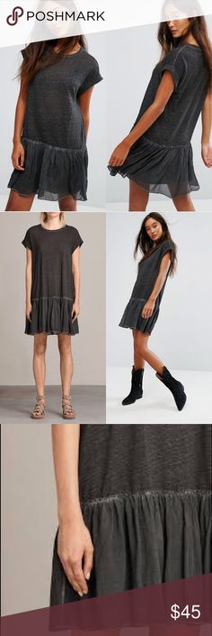 ALLSAINTS Jody Jersey Dress - Black, M ALLSAINTS puts a fresh spin on this linen-blend staple with a softly ruffled hem for feminine flair.  Designed for a contemporary fit Round neck, short sleeves, rolled cuffs Shirred skirted hem, pullover style Linen; contrast: viscose Hand wash Made in Portugal Color:  Listed as black, but looks like a dark gray.  Excellent preowned condition.  Offers welcomed!  P13 All Saints Dresses