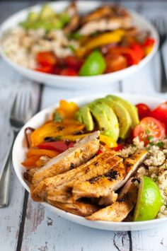 Chicken Fajita Bowl with Cauliflower Rice. A paleo meal-in-a-bowl. Succulent fajita chicken, peppers, tomatoes, avocado and cilantro-lime cauliflower rice, all in one bowl, makes a tasty Tex-Mex dinner.