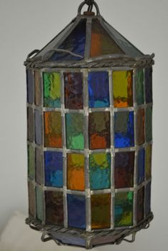 Antique Leaded Stained Glass Lantern. I was at a restaurant and saw these, and I want one! I haven't been able to find one for sale online, so I may have to make one?
