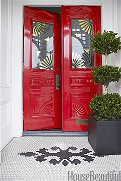 Create a Friendly EntryReviving an Early American symbol of welcome, designer Ken Fulk painted the front doors of a San Francisco Victorian Benjamin Moore Heritage Red. The designer also echoed existing carved-fan motifs in new gilt stencils on the glass.    Share69