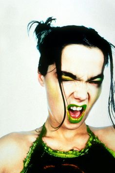 Björk, green lipped for a photo shoot. The most colorful thing about Björk is her attitude! Enjoy RUSHWORLD boards, BJORK FOUR DECADES OF OTHER-WORLDLY MUSIC, UNPREDICTABLE WOMEN HAUTE COUTURE and AWAKE AWARE AMERICA. Follow RUSHWORLD! We're on the hunt for everything you'll love! #Bjork #BjorkPhotos